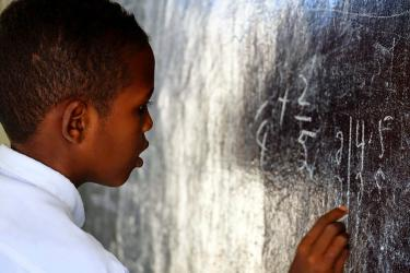 A student in Somalia writes on the blackboard. Credit: UNICEF / Hana Yoshimoto