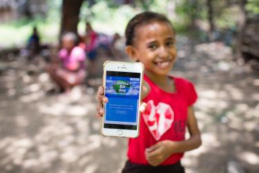 A girl in Timor Leste shows off the online platform on which she can access online learning during school closures. Credit: UNICEF/UNI320751/Soares