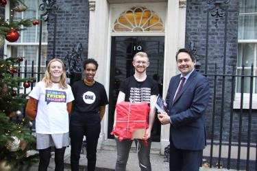Student campaigners stand in front of the Prime Minister's home in London with MP Stephen Twigg