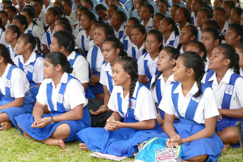 Students sitting on the grass during the official opening ceremony of the Safata College's newly constructed multistory classroom block in Samoa – February 2018. Credit: US Embassy In New Zealand/Flickr