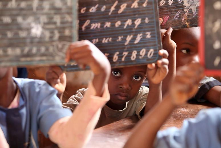 Students lifting their slates during a lesson in a school in Cameroon.