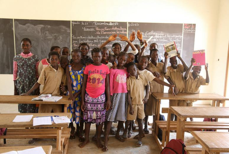 Students gathered in front of the blackboard. Cote d'Ivoire. Credit: GPE/Carine Durand