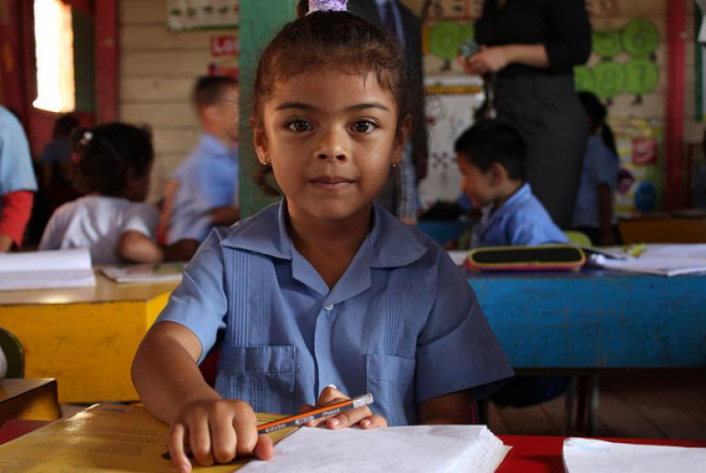A young girl in class at the Tim Hines school in Tegucigalpa, Honduras. The school sets a good example of how community efforts and the involvement of parents make a positive impact for students. Credit: GPE/Carolina Valenzuela