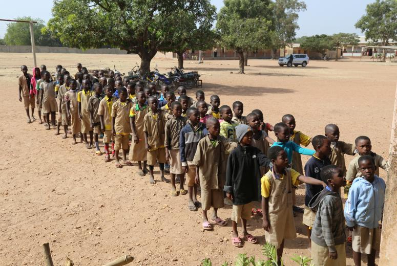Children line up outside of their classrooms after lunch at Saka Primary School in Kandi, Benin.