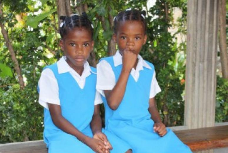 Two school girls look at the camera. St Vincent & the Grenadines.