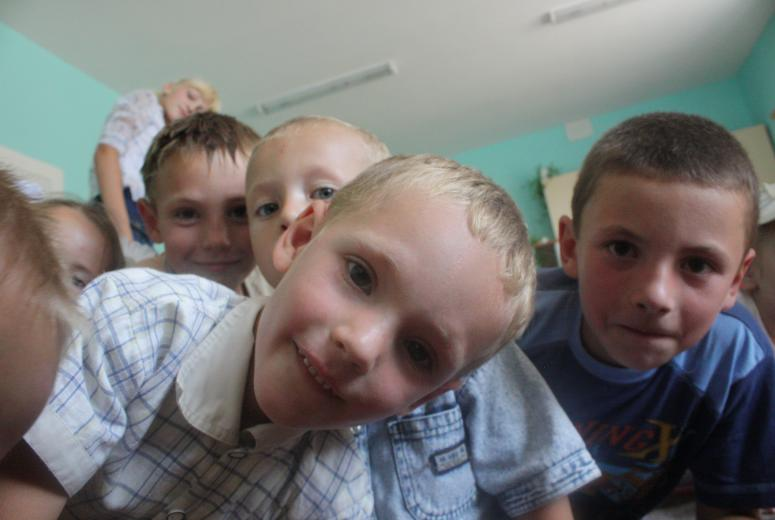 A few students pose for the camera in a primary school in Moldova.