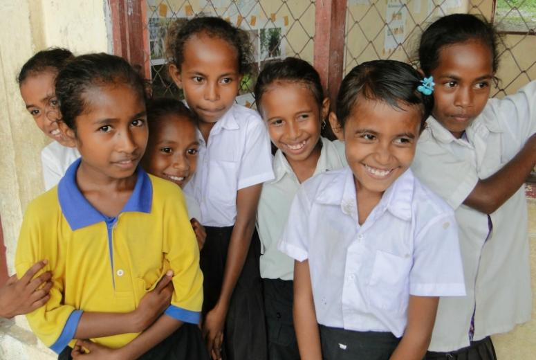 Outside of their classroom, a few students of a primary school in Timor Leste smile. March 2013.