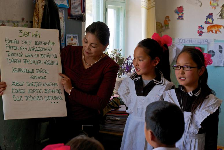 "In rural schools across Mongolia, students and teachers create ""big books"" based on stories they read from classroom libraries, a teaching method that effectively improves students' reading skills. Dadal County, Mongolia."