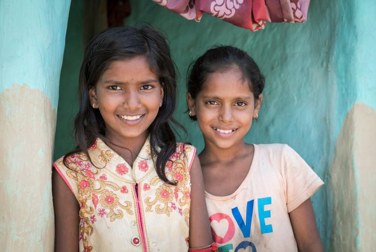 Barsha Kumari Pashawal (left) is 12 and recently got back to school. Nepal