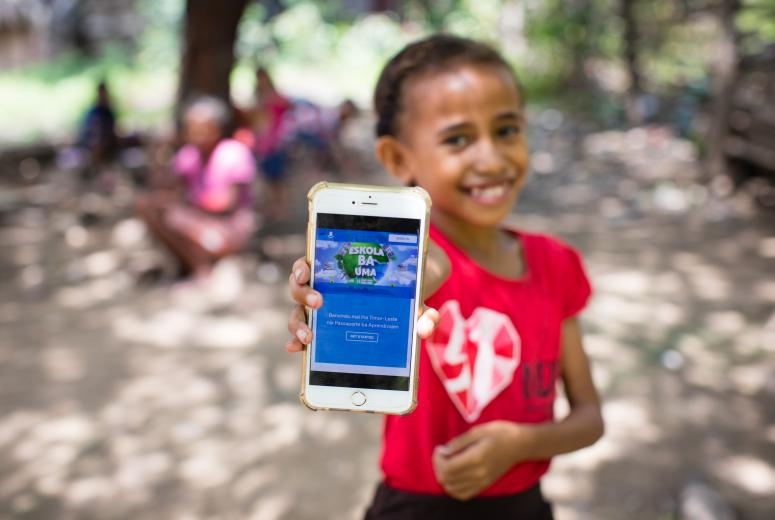 On April 14, 2020, a girl shows off the online platform on which children and parents in Timor-Leste can access a range of audio-visual material to help students continue learning during ongoing school closures. Television programs, radio programs and e-books, as well as a book for parents to explain COVID-19 to children with neurodevelopmental needs, are available on the Learning Passport platform developed by Microsoft, UNICEF and the University of Cambridge. Schools in Timor-Leste have been closed since March 23, 2020 as part of national efforts to prevent the spread of COVID-19. Credit: © UNICEF/UNI320751/Soares