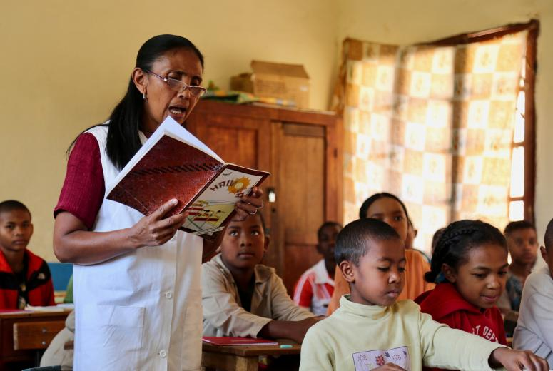 Fidèle - a fifth grade teacher in Antananarivo, Madagascar - reading aloud to her students from a textbook. Credit: GPE/Carine Durand