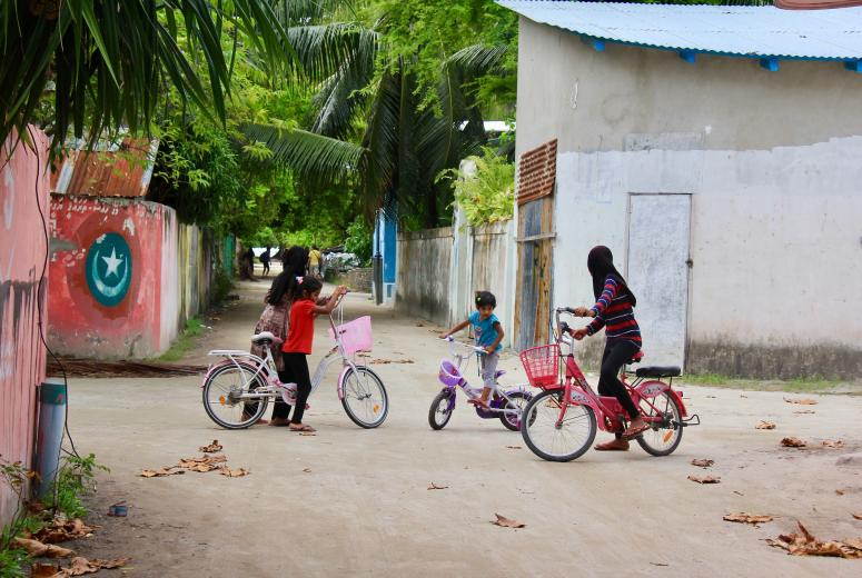 Children playing outside in Hangnaameedhoo Island, Maldives. Credit: Catherine Ph Huay Tan