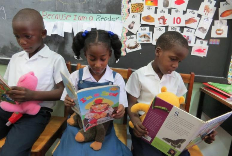 Kindergarten students from the Seventh Day Adventist Primary School in Grenada reading.