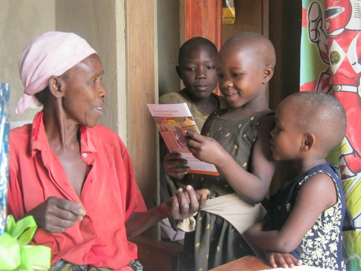 A Grandmother reads with her grandchildren, Bushenyi District, Uwezo Uganda Credit: Hamis Adam/Save the Children