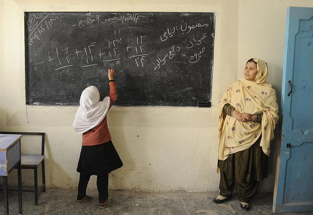 A girl at the blackboard at Ayno Meena Number Two school in the city of Kandahar, Afghanistan.