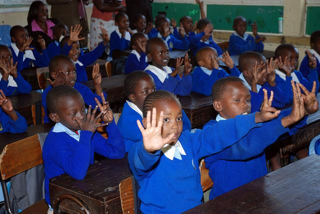 Children raising their hands at a public school in West Langata area of Nairobi, Kenya (c) GPE/Mediabase