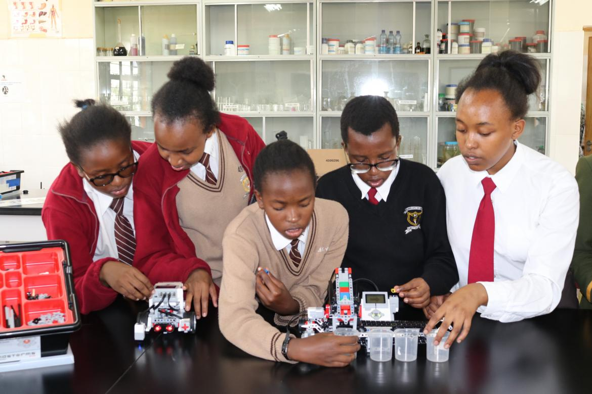 Students engaged in a robotics session during an education tour to CEMASTEA – Copyright: CEMASTEA, 2018
