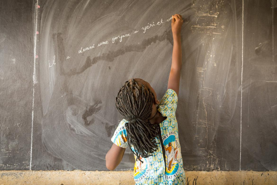 A girl writes on the board in a classroom in Burkina Faso. Credit: GPE/Kelley Lynch
