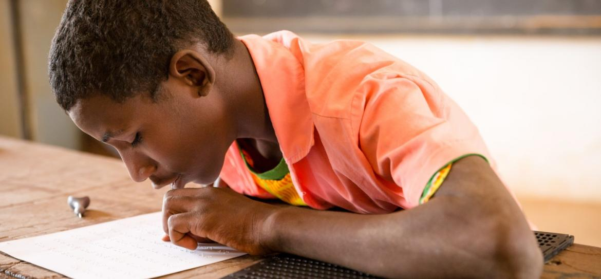 A child reads in Braille in a school in Niger. Credit: GPE/Kelley Lynch