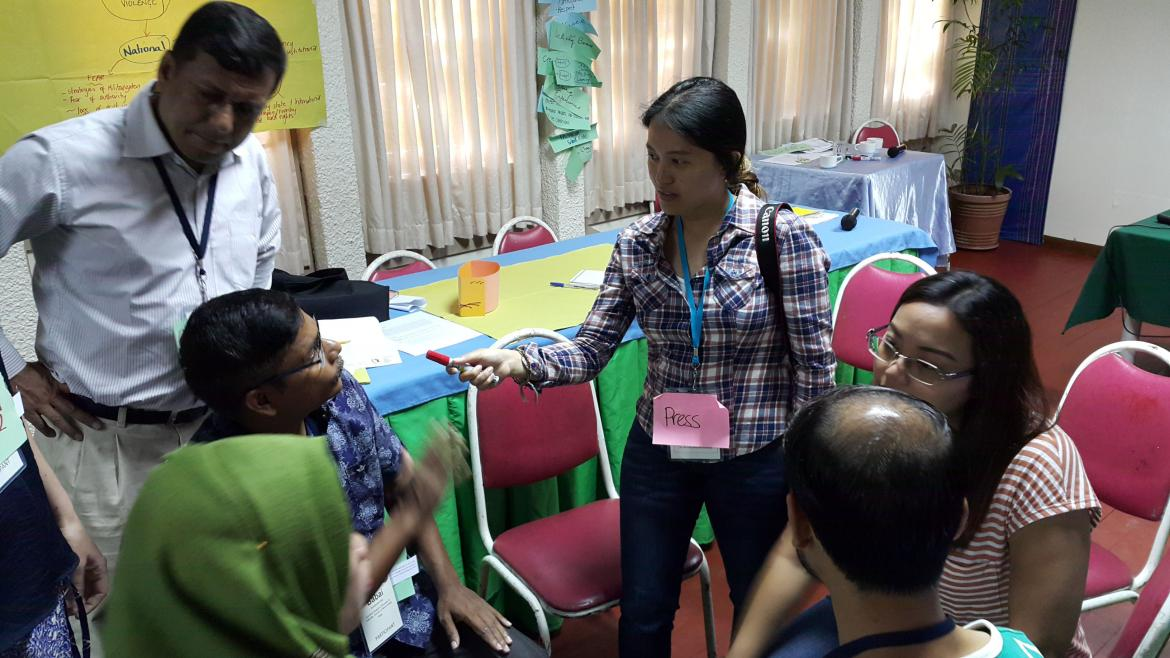 During a simulation exercise at the Mindanao Peacebuilding Institute in the Philippines, a participant playing the role of the press carries out an interview. Credit: Jonathan Rudy
