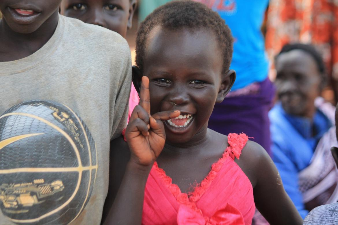 Happy girl at Kiryandongo refugee settlement.  Uganda. Credit: GPE/Henry Bongyereirwe