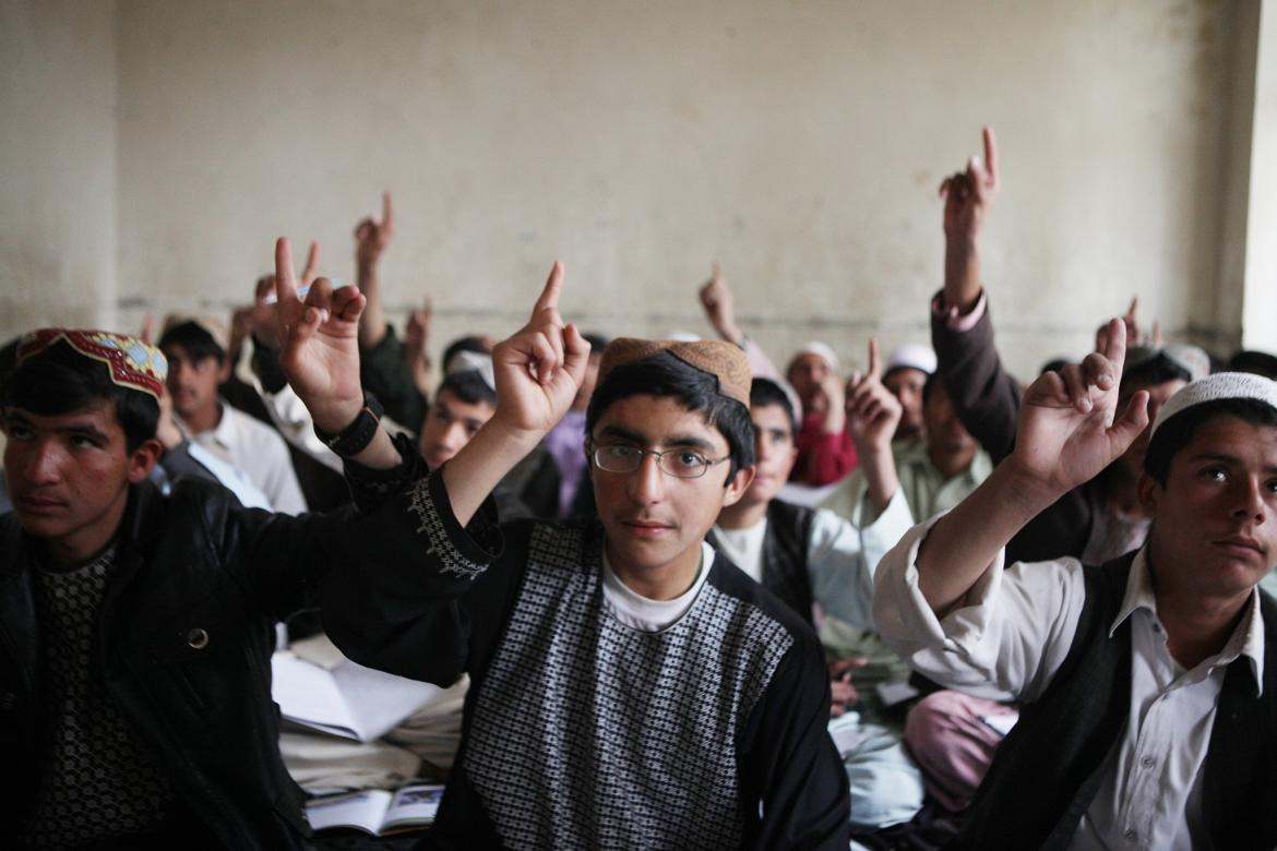 Students volunteering to answer a question at the Fazel Kandahari High School. Afghanistan. Credit: GPE/Jawad Jalali