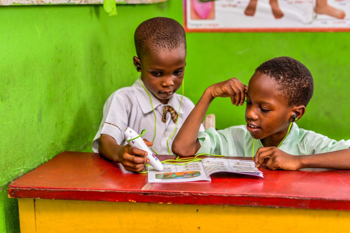 Children using the talking pens and books from Mavis Computel in Lagos, Nigeria. Credit: Mavis/Computel