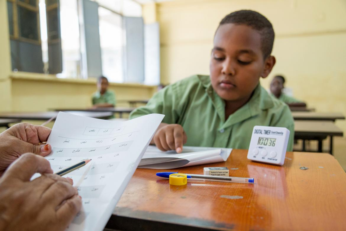 A student identifies letters during the GPE supported National Learning Assessment in Sudan