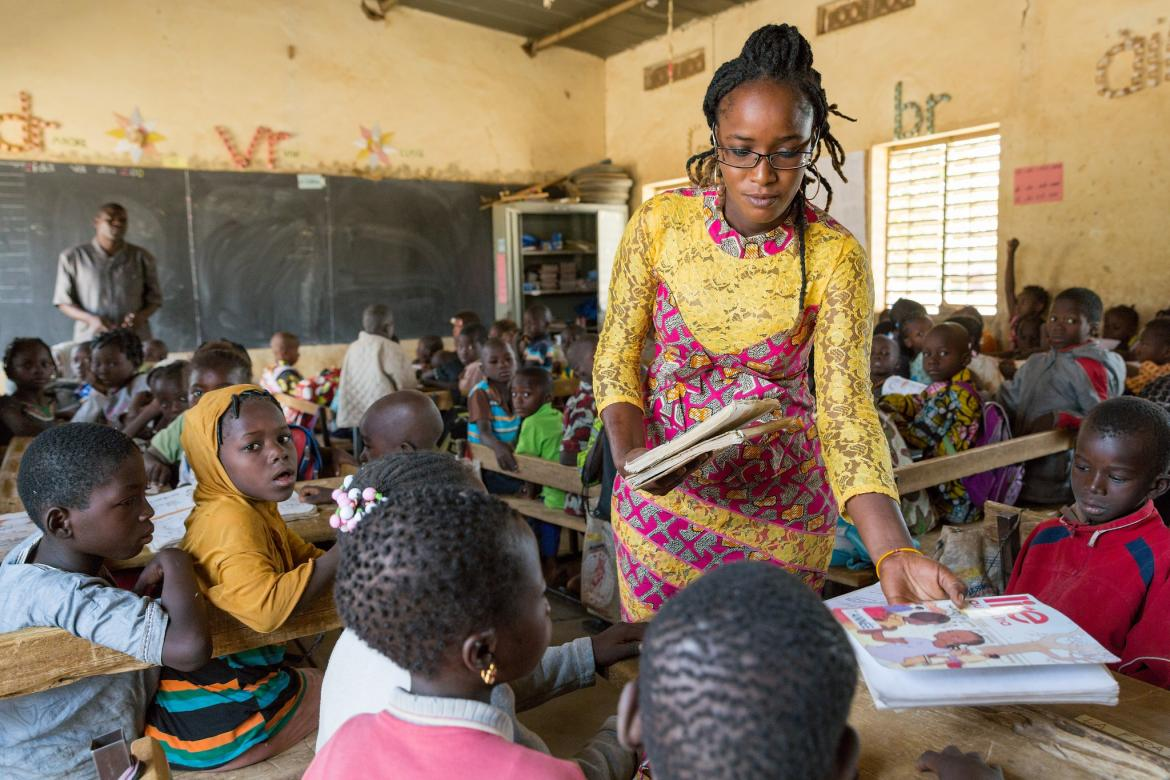 A teacher trainee helps out in class. Burkina Faso. Credit: GPE/Kelley Lynch