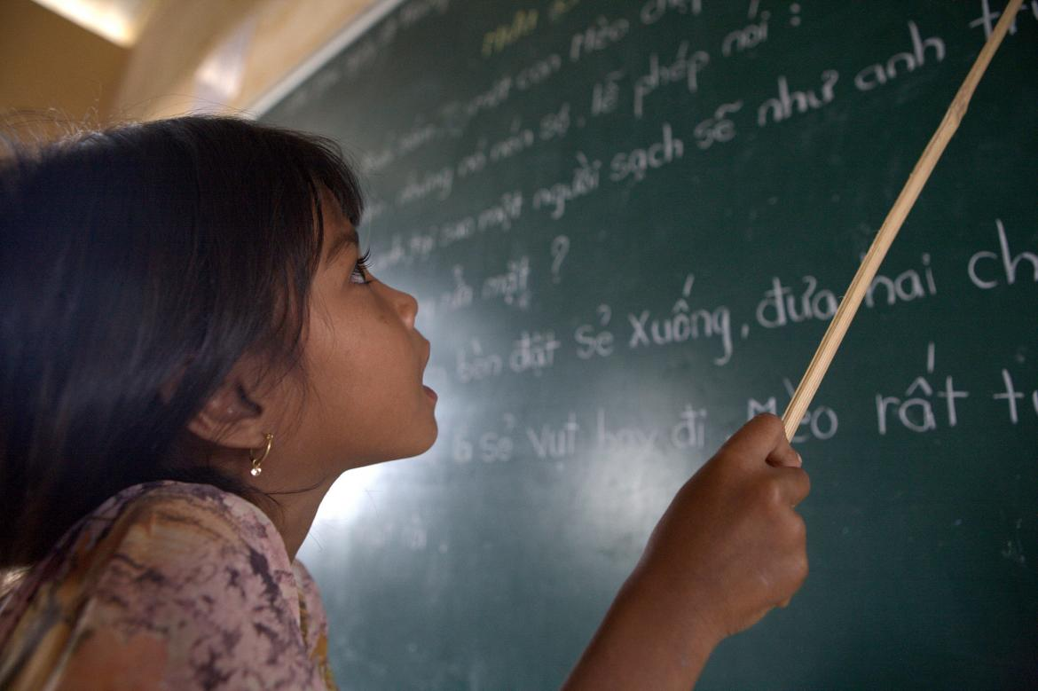 A student of Khmer descent learns Kinh language (the official Vietnamese language) at the Lac Hoa Primary School in Soc Trang province. Vietnam