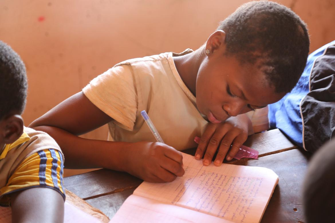 A young girl rights takes notes in class. Saka primary school, Benin. Credit: GPE/Chantal Rigaud