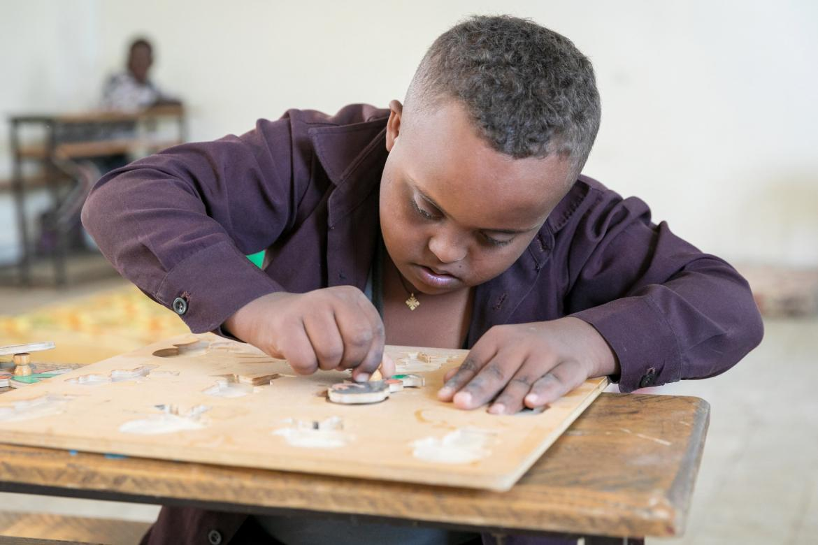 Fasil, 11, works a puzzle at the Felege Abay Elementary School, Bahar Dar, Ethiopia.