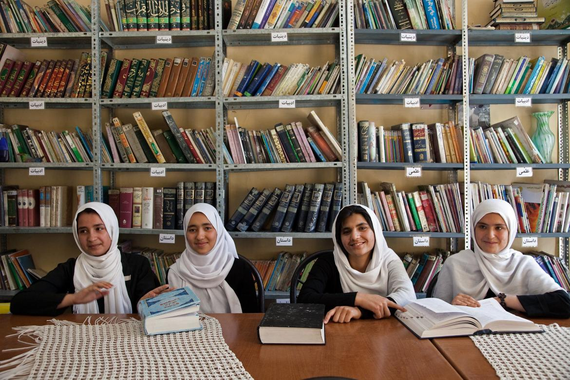 From right Parisa (16), Marzia (18), Maria (16) and Muzhgam (17) study in the library at the Female Experimental High School in Herat. Afghanistan.
