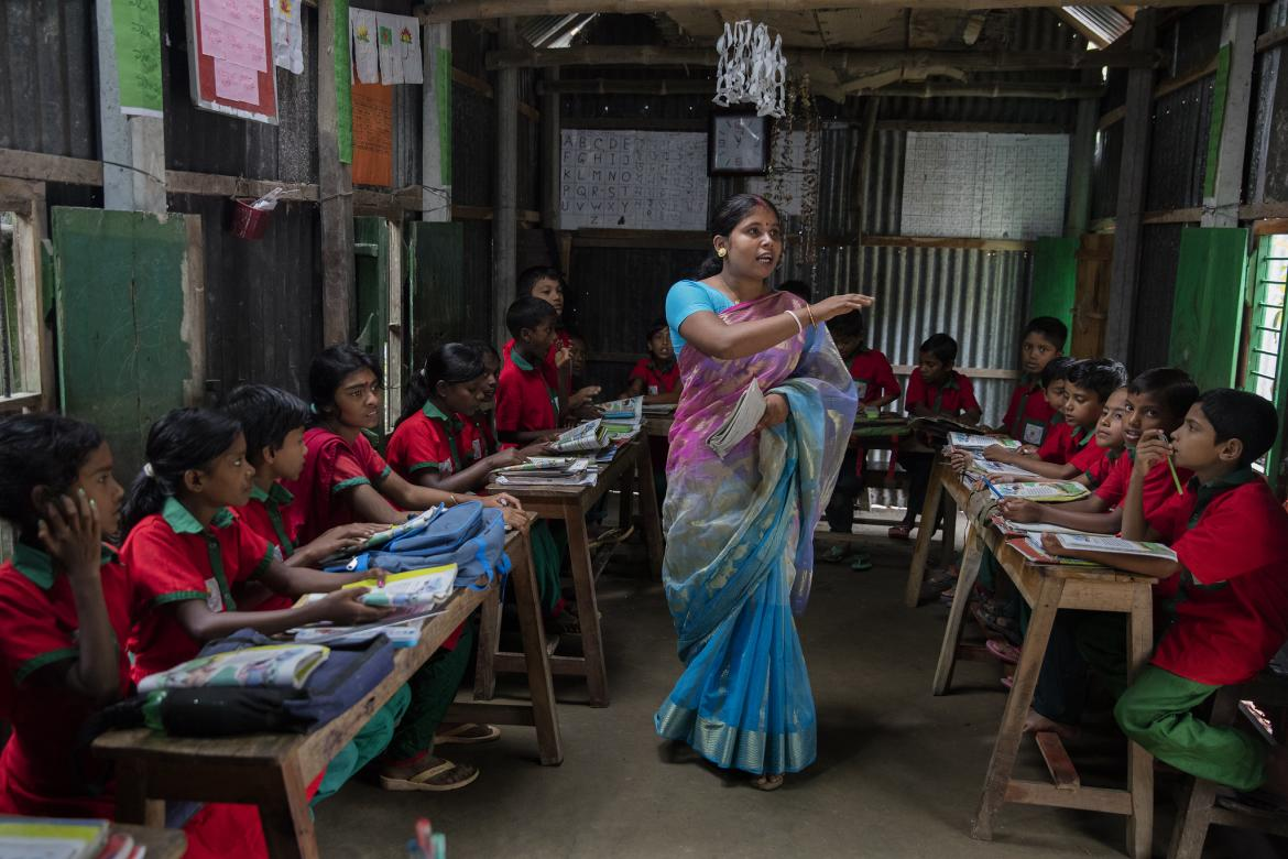 Students listen to their school teacher, Shuma Das during class at the Sahabatpur Daspara Ananda school in Sahabatpur village, Bangladesh on October 12, 2016. Photo credit: Dominic Chavez/World Bank