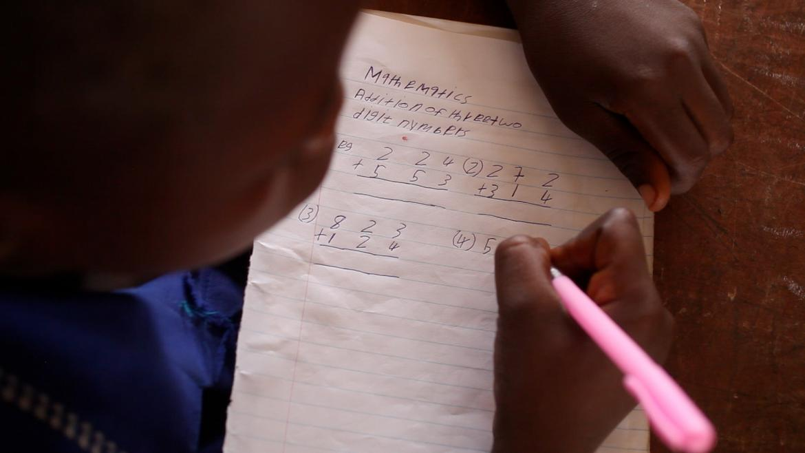 A student working in class in Sierra Leone. January 2015.