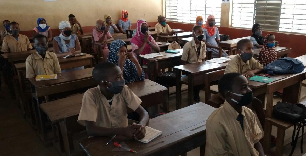 Students at a school in Mamou, Guinea, wearing masks and practicing social distancing Credit: Aboubakar Sidiki, Dec. 2020