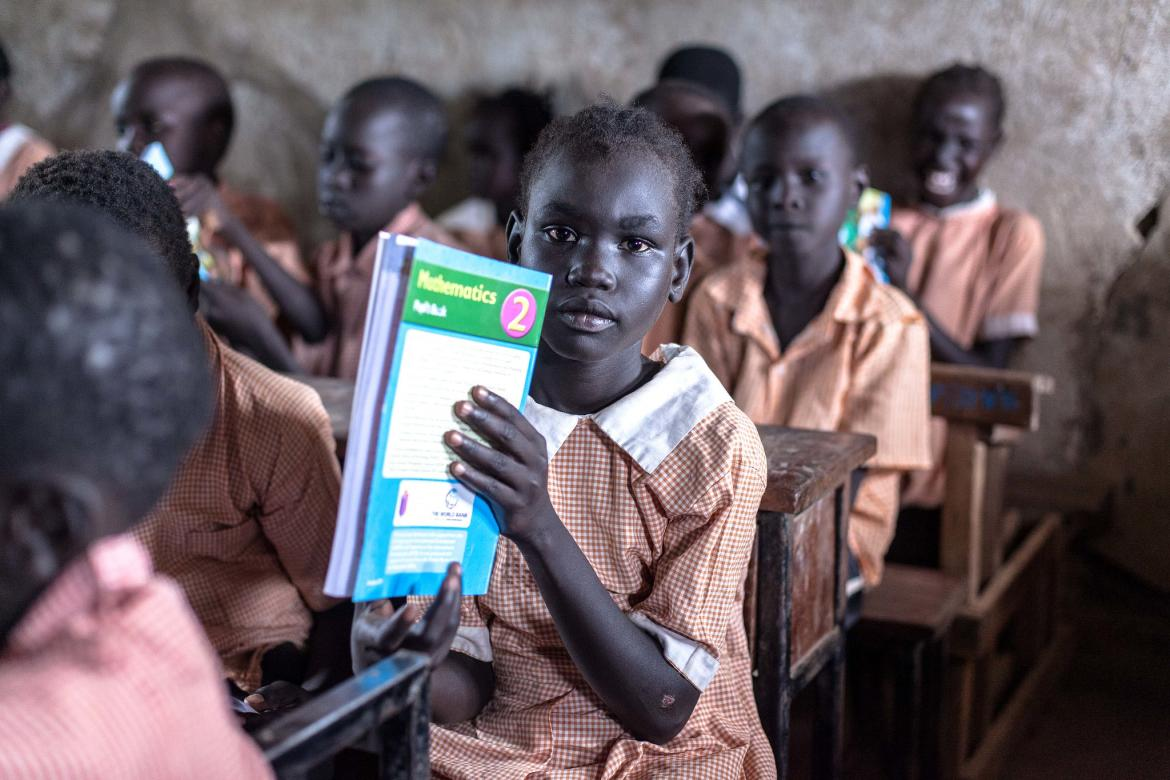 Students in class at the Kakuma refugee camp in Kenya in October 2017. The GPE-funded PRIEDE project distributed textbooks via UNHCR to refugees and IDP children in the camp.