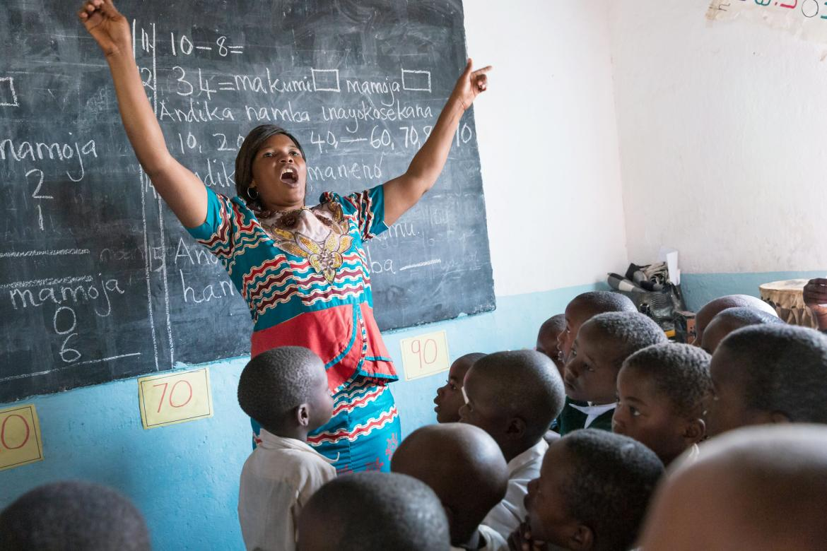 A teacher teaches through song during her class at the Kivukoni Primary School, Mpanda MC, Katavi inTanzania. August 2019