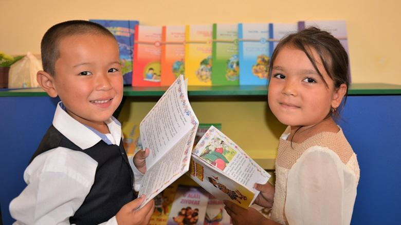 Students from the Preschool #7 in Mallaboy village, which is located 180 km from Tashkent, the capital of Uzbekistan, holding reading books. Credit: Mirzobek Ibragimov/World Bank.
