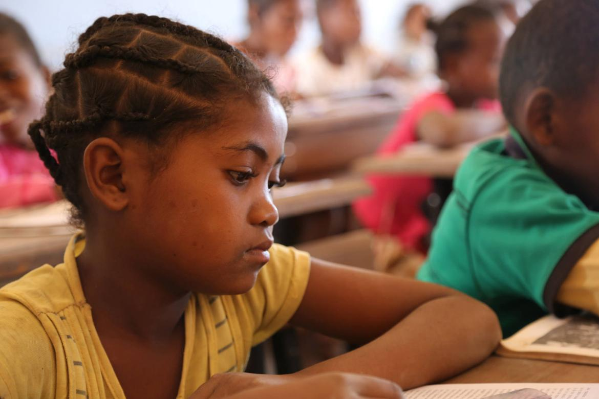 A girl sitting at her desk at a primary school in Madagascar. Credit: GPE/Carine Durand