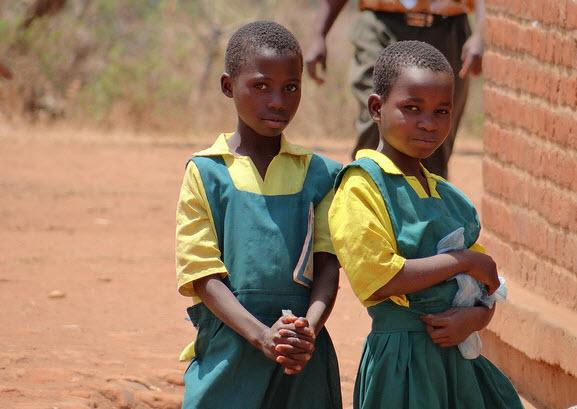 Two girls in their uniforms outside of their primary school in Malawi (c) GPE/Tara O'Connell