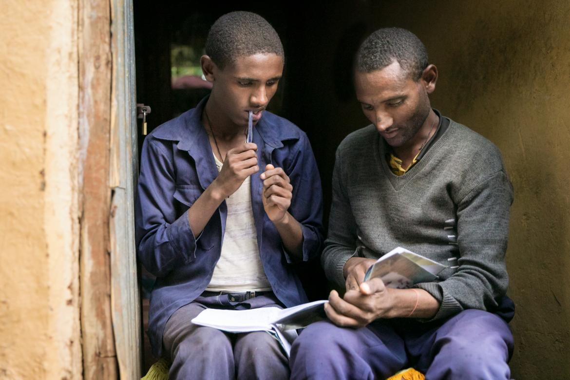 Chalachew and his father are both in grade 1 and usually help each other with homework.