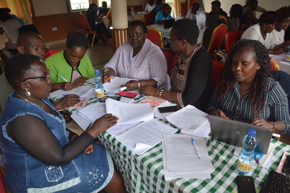 Panelists in a working group developing course materials in their local language during a workshop in Naivasha organized by KICD. Credit: KICD