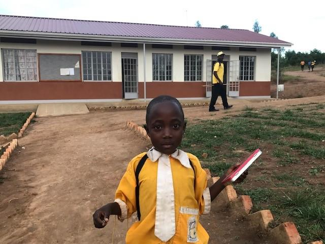 A young student at the new school block at St. Lawrence Primary School. Uganda. Credit: GPSA