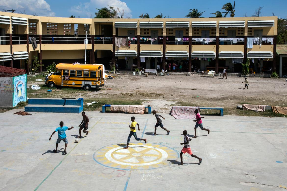 Boys play soccer in the yard of Ecole Pierre Guerrier, which is currently in use as a living space or shelter for several hundred people who have lost their homes to Hurricane Matthew. © UNICEF/UN035680/LeMoyne