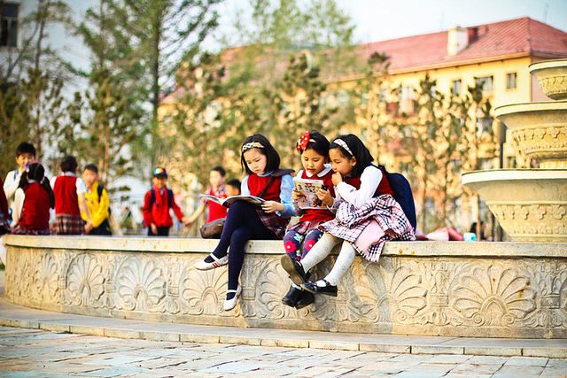 These girls share a book outside after school. This is important because what they are reading helps them gather information that they may need in the future. (C) Enkhtulga Enkhbayar, Mongolia