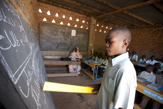 A boy reads at the blackboard in Chad. Credit: Educate a Child