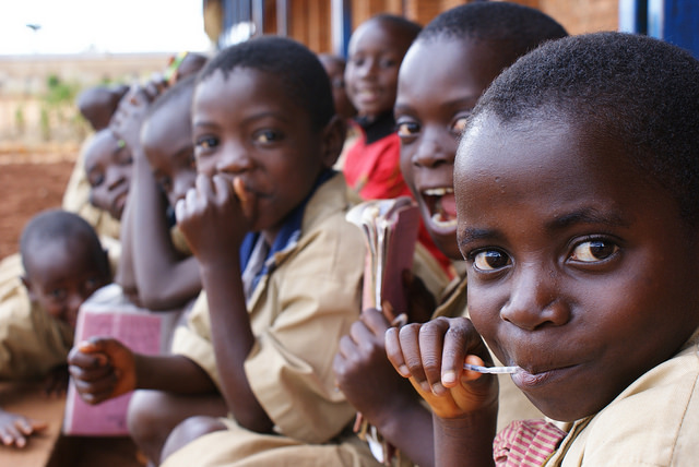 Children sitting down outside of their school in Burundi. Credit: UNICEF Burundi/Krzysiek