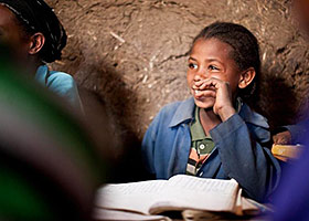 Bontu regularly borrows books from her local Literacy Boost Book Bank, a mobile library in her village of Boda, Ethiopia supported by Save the Children. She likes to read with her reading buddy, Kebenu, a 10-year-old boy who lives nearby. (c) Katherine Brown, United States