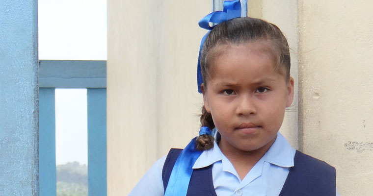 A school girl in Guyana looks at the camera. Credit: GPE/Tara O'connell